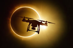 Drone silhouette on total solar eclipse background. Silhouette of flying drone on total solar eclipse background Royalty Free Stock Images