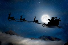 Silhouette of a flying goth santa claus against the background of the night sky. royalty free stock photography