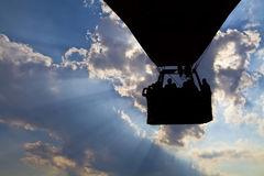 Silhouette of flying hot air balloon. On a blue sky background Stock Photo