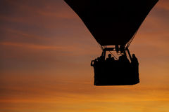 Silhouette of flying hot air balloon Stock Images
