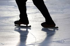 Silhouette foot ice-skating person on the ice rink. The silhouette foot ice-skating person on the ice rink Stock Photography