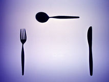 Silhouette of a fork, knife and spoon. Abstract design Royalty Free Stock Photos