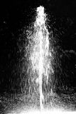 Silhouette of fountain. The fountain in the park is shining beautifully in reverse rays royalty free stock images