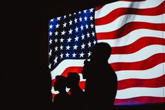 Silhouette of Four Person With Flag of United States Background royalty free stock photo