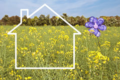 Silhouette frame of a house, meadow with flowers Royalty Free Stock Image