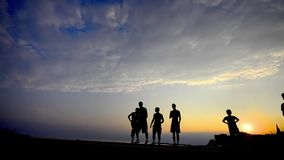 Silhouette of free runners at sunset. stock footage