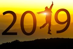 Silhouette of freedom happy young woman jumping on on the hill with New year 2018 concept in sunset background stock images