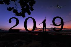 Silhouette freedom young man on the stone in sunrise or sunset o royalty free stock image