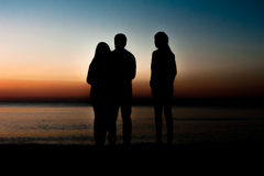 Silhouette of friends on beach Royalty Free Stock Photography