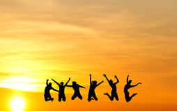 Silhouette of friends jumping Royalty Free Stock Photo