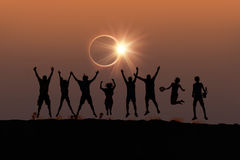 Silhouette of friends jumping at Solar Eclipse royalty free illustration