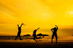 Silhouette of friends jumping Royalty Free Stock Photography