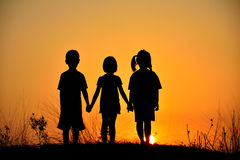 Silhouette friendship of three. Silhouette  friendship of three on sunset mountain Stock Images