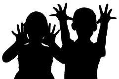 Silhouette frightening children. Who raised their hands royalty free stock image