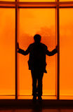 Silhouette in front of orange Stock Photos