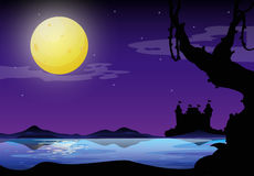 Silhouette. Of a full moon night with purple sky and castel on the other side of the river Royalty Free Stock Photo