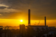 Silhouette of gas turbine electrical power plant against sunset Stock Images
