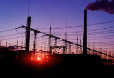 Silhouette of gas turbine electrical power plant against sunset. royalty free stock photography