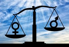 Notion of the superiority of women over men. Silhouette of gender symbols on the scales of justice where the female symbol predominates. The notion of the Stock Images