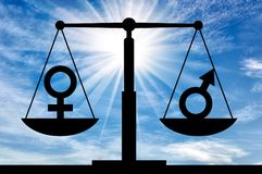 Concept of equal rights for women with men. Silhouette of gender symbols on the scales of justice which are equal in rights. The concept of equal rights for stock image
