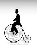 Silhouette the gentleman the cyclist by old bicycle Stock Image