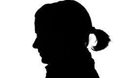 Silhouette of a girl. Silhouette of a happy girls profile isolated on white stock photography