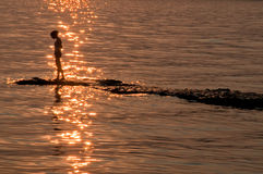 Silhouette of a girl. On a Garda lake, Italy royalty free stock images