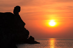 Silhouette of a girl. On a background of sea sunset Stock Images