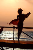 Silhouette of girl. Dancing with scarf Royalty Free Stock Photography