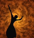Silhouette of the girl. The ballerina on a background of fire Stock Image