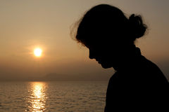 Silhouette of a girl. At the sunset Royalty Free Stock Images