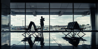 Silhouette of a girl in an airport terminal Royalty Free Stock Images