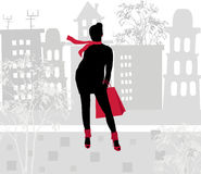 Silhouette of a girl on the background of the city Stock Image