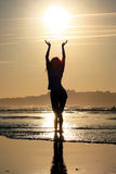 Silhouette of a girl on the background of the ocean