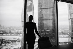 Silhouette of a girl on the background of skyscrapers Stock Photos