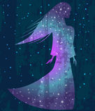 Silhouette of the girl on the background of stars Stock Photo