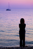 Silhouette of a girl on the beach Stock Image