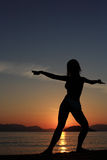 Silhouette of a girl at the beach Royalty Free Stock Photos