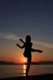 Silhouette of a girl at the beach Royalty Free Stock Photo
