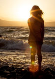 Silhouette  a girl at the beach at sunset  evening Royalty Free Stock Image