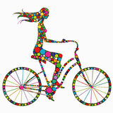 Silhouette of a girl on a bicycle Royalty Free Stock Image
