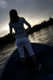 Silhouette of a girl, on the boat. A young and nice girl on the boat Royalty Free Stock Photography