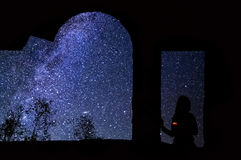 Silhouette of a girl with a candle аnd the starry sky with the milky way Royalty Free Stock Images