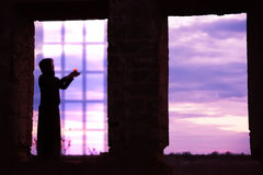 Silhouette of a girl with a candle Stock Images