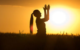 Silhouette of girl clapping hands at sunset Stock Photography