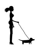 Silhouette of a girl with dachshund Stock Images