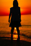 Silhouette of a lady dancing by the sea Royalty Free Stock Photography
