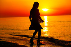 Silhouette of a lady dancing by the sea Royalty Free Stock Photos