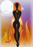 A silhouette of a girl demon. Against a background of fire Royalty Free Stock Photo
