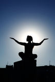 Silhouette of girl doing  yoga poses Stock Photo
